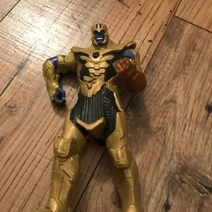 Thanos action figure. Lights up, makes noise.